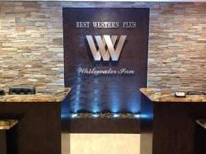 hotel water wall harrison ohio water feature front desk brown scored acrylic 2